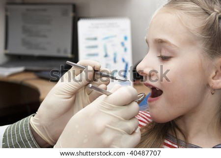 The girl on reception at the dentist. Close-up - stock photo