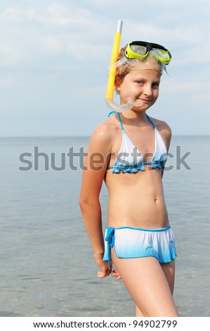The girl on seacoast. In a mask, and with a snorkel - stock photo