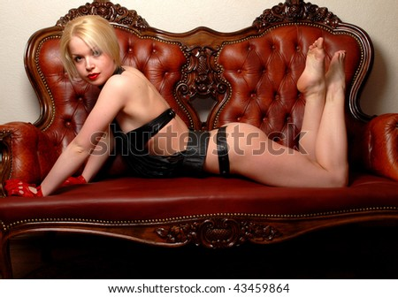 The girl on the couch - stock photo