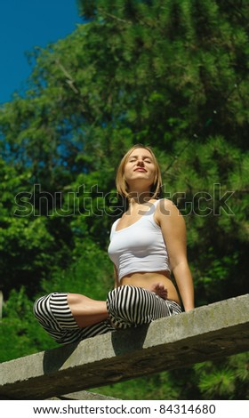 The girl on the nature - stock photo
