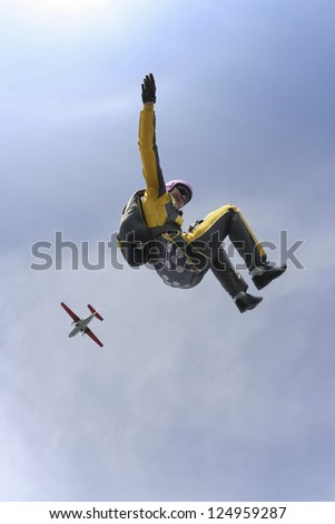 The girl parachutist in free fall. - stock photo
