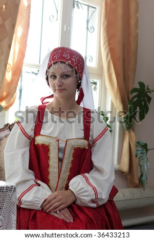 The girl poses in Old Russian clothes - stock photo