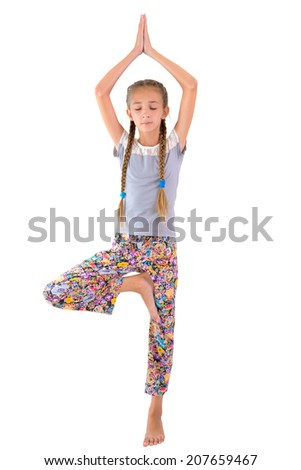 The girl practices yoga on the white background - stock photo