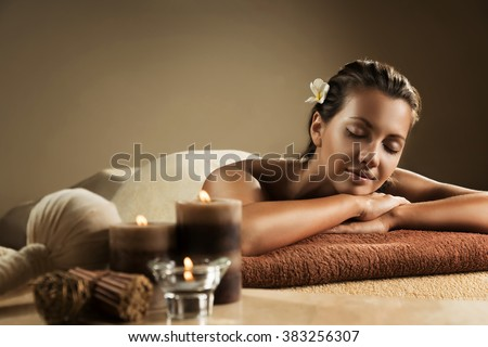 The girl relaxes in the spa salon - stock photo