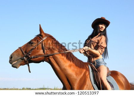 the girl rider walking his horse - stock photo