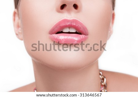 The girl's face, close-up lips, mouth open, white teeth are beautiful on a white background. Beautiful mouth, open mouth, white teeth. CLOSE BIG female lips, beautiful white teeth. Mouth and lips - stock photo