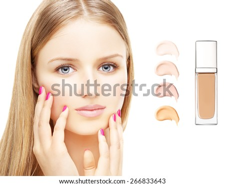 The girl's face with a fresh and beautiful skin . Liquid foundation   on white background - stock photo
