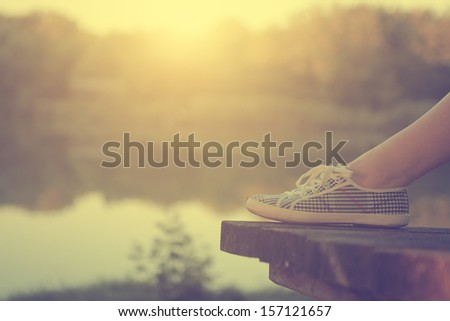 The girl's leg and retro shoes - stock photo