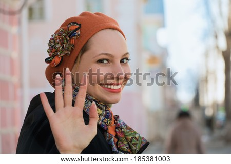 The girl says goodbye in the street - stock photo
