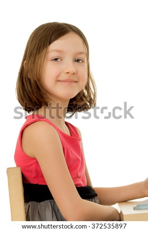 The girl sitting at the table - stock photo