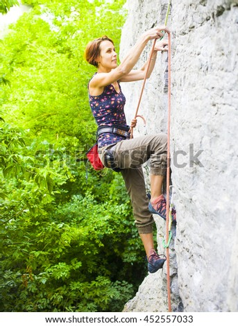 The girl spends time actively engaged in climbing. - stock photo
