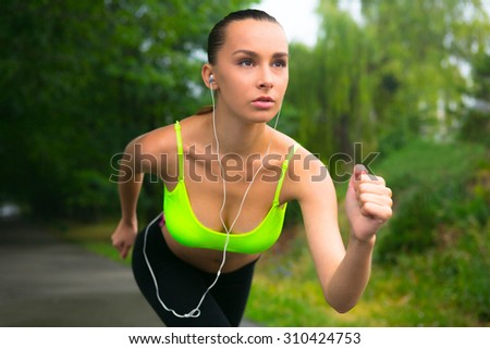 The girl stands at the start, to run right now. She is sure that will come running first - stock photo