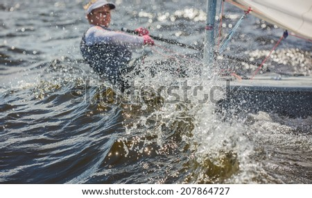 The girl  to a yacht does turn - stock photo