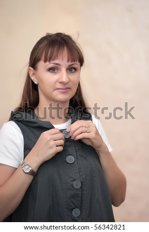 The girl tries on a dress in a store - stock photo