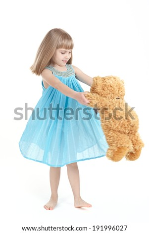The girl whirls with teddybear  - stock photo