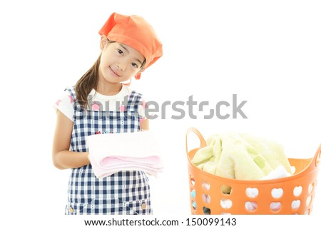 The girl who enjoy helping with housework - stock photo