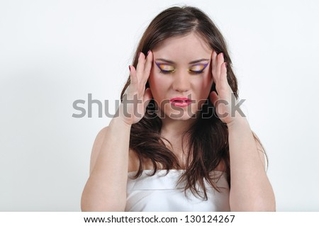 The girl with a make-up is hurt by the head - stock photo