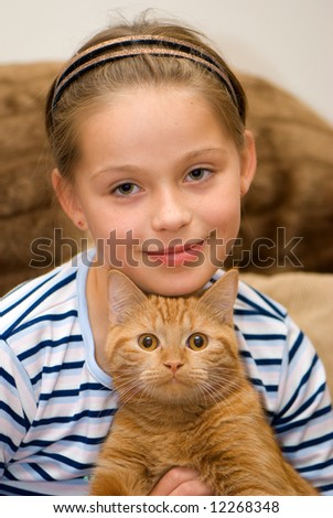 The girl with a red cat. A portrait - stock photo