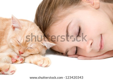 The girl with a red kitten of breed Scottish-straight are photographed on the white background - stock photo