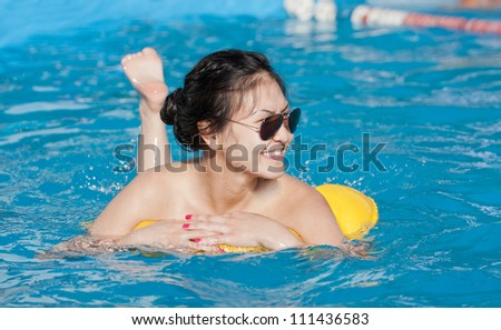the girl with a swimming cylinder - stock photo