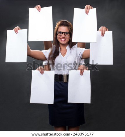 The girl with hands holds many forms - stock photo