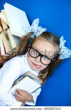 The girl with the books preparing to the new school year - stock photo