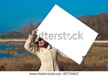 The girl with the poster for advertising - stock photo