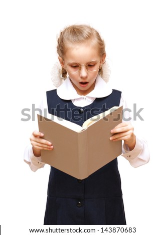 The girl with the round glasses reading a book - stock photo