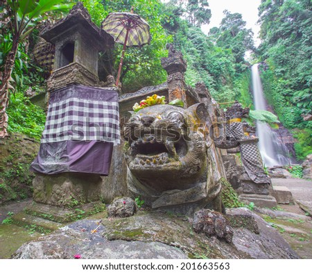 The gitgit waterfall with Hindu temple on singaraja, bali, indonesia - stock photo