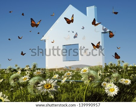 The glass model of a house on grass. - stock photo