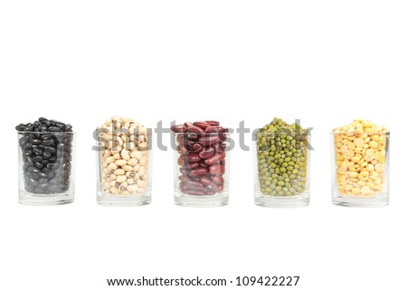 The glass of different legumes are  on a white background - stock photo