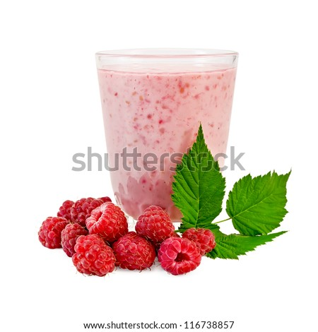 The glass of milkshake, berries and green twig of raspberry isolated on white background - stock photo