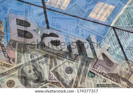 The glass wall of the building with the inscription Bank and U.S dollar notes - stock photo
