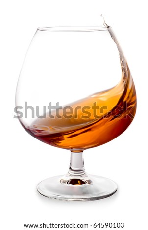 The glass with splashes brandy - stock photo