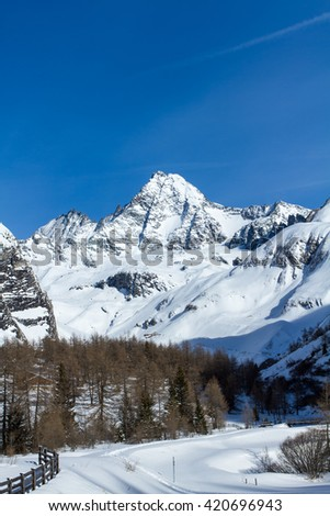 The Glossglockner, Austria's highest mountain located in the Hohe Tauern national nature reserve of Tirol, as seen from the south with the Koednitz valley below on a sunny day in the middle of winter. - stock photo