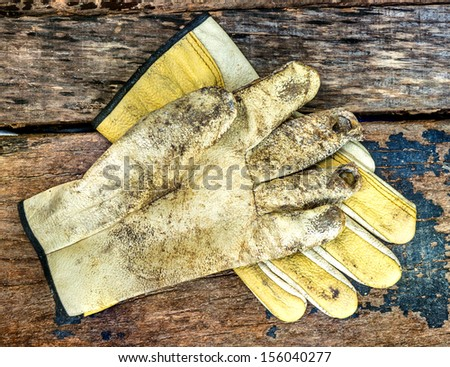 The glove on wood texture. - stock photo