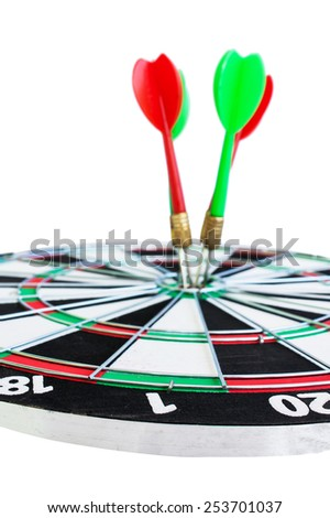 The goal of business is intended to accomplish as a team darts on dark gray background with arrows, middle target - stock photo