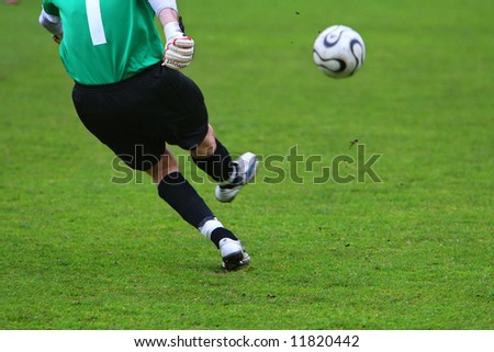 The goalkeeper punches a ball from a gate - stock photo