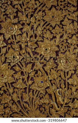 The gold stucco design of native thai style on the Wall. Golden Thai decorative carve artistic pattern from Thai temple - stock photo