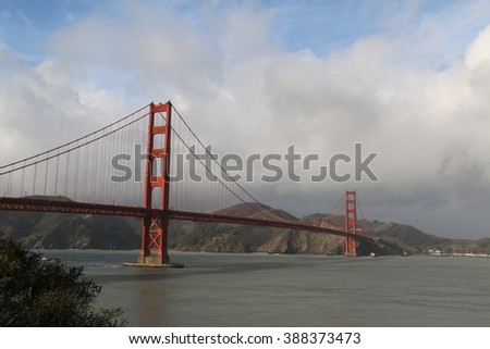 The Golden Gate Bridge, a suspension bridge spanning the Golden Gate strait, is one of the most internationally recognized symbols of San Francisco. - stock photo