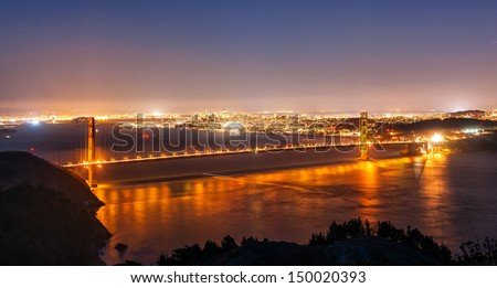 The Golden Gate bridge and San Francisco at night - stock photo
