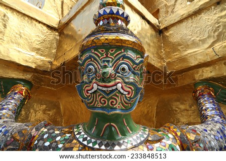 The Golden Pagoda and Yak statue at the phra kaew, bangkok,Thailand - stock photo