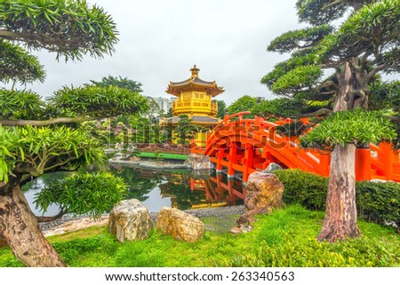 The Golden Pavilion of Perfection in Nan Lian Garden, Hong Kong. It is designed in the Tang Dynasty-style with hills, water features, trees, rocks and wooden structures. - stock photo