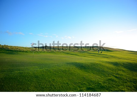 The golf player is  playing on the nice golf course fairway. - stock photo