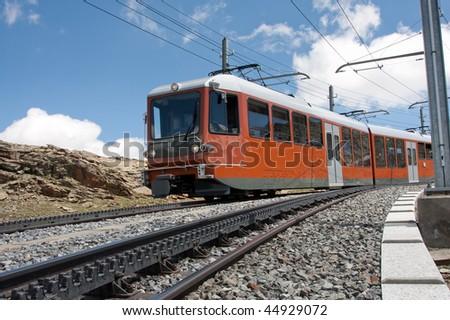 The Gornergrat railway rides up the mountain - stock photo