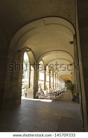 The Gothic arches of the royal square. The Royal Plaza is a square in the Gothic Quarter in Barcelona. Located next to La Rambla and is a well-known tourist attraction, especially at night. - stock photo