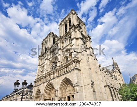The gothic style Notre Dame in Paris with dramatic clouds - stock photo