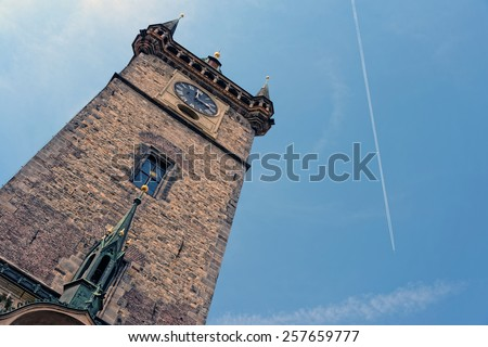 The Gothic tower of the Old Town Hall in the Old Town Square of Prague, Czech Republic. - stock photo