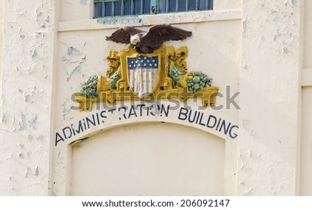 The government Seal depicting the bald eagle, coat of arms and american flag at the entrance of the Administration Building on Alcatraz island prison, now a museum in San Francisco, California, USA. - stock photo
