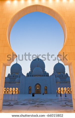 The grand mosque framed by the entrance arch - stock photo